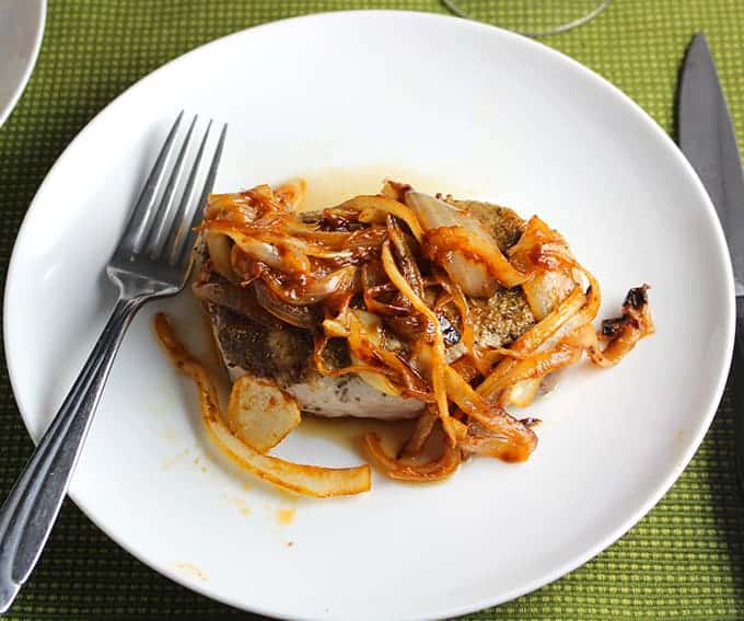 Cumin Sage Rubbed Pork Chops topped with a quick and tasty onion pan sauce.