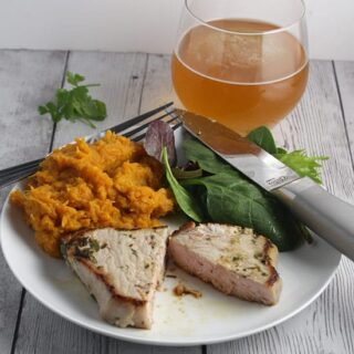 Easy Cilantro Lime Pork Chops paired with a crisp, refreshing beer.