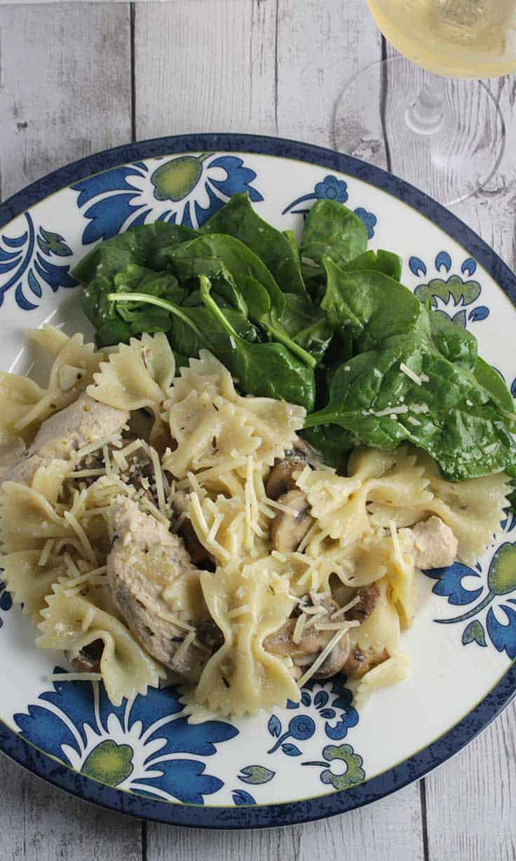 Chicken Mushroom Bowtie Pasta with Garlic Cream Sauce, a hearty and delicious dinner recipe that can be on the table in 30 minutes.