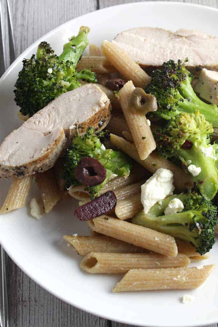 Grilled Chicken Broccoli and Garlic Penne on a plate.