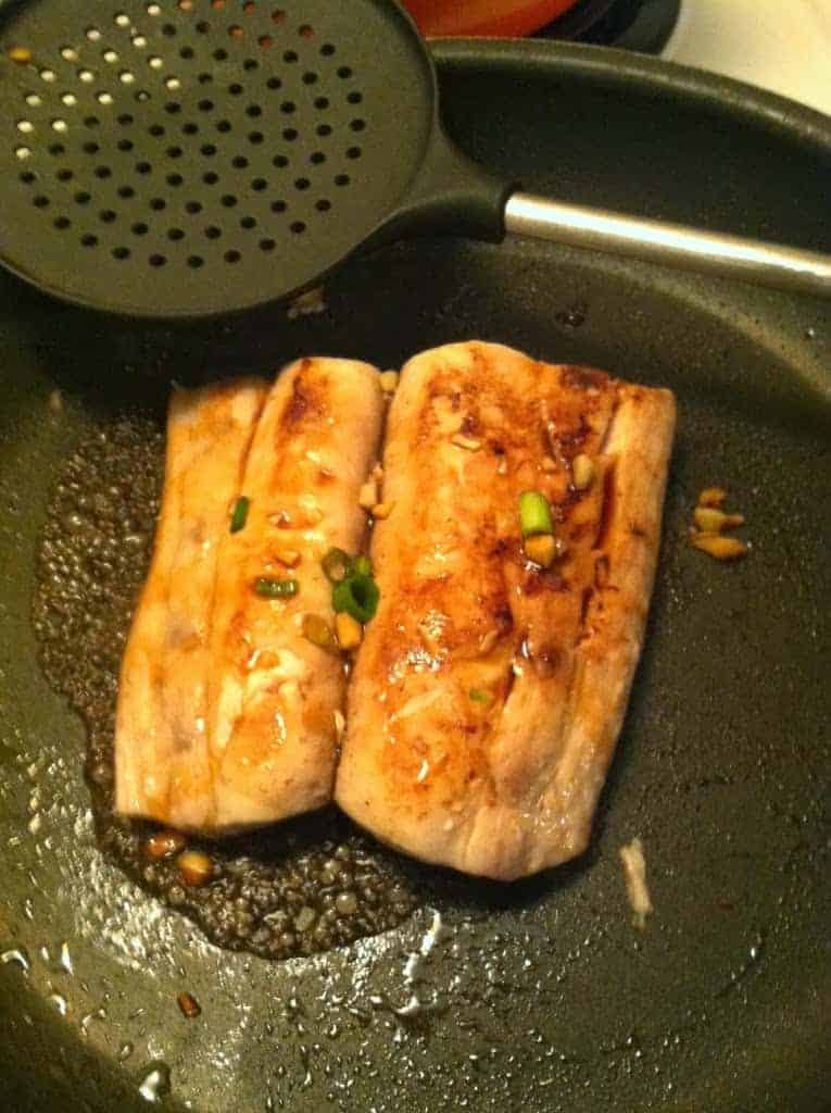 cooking mahi mahi in a skillet.