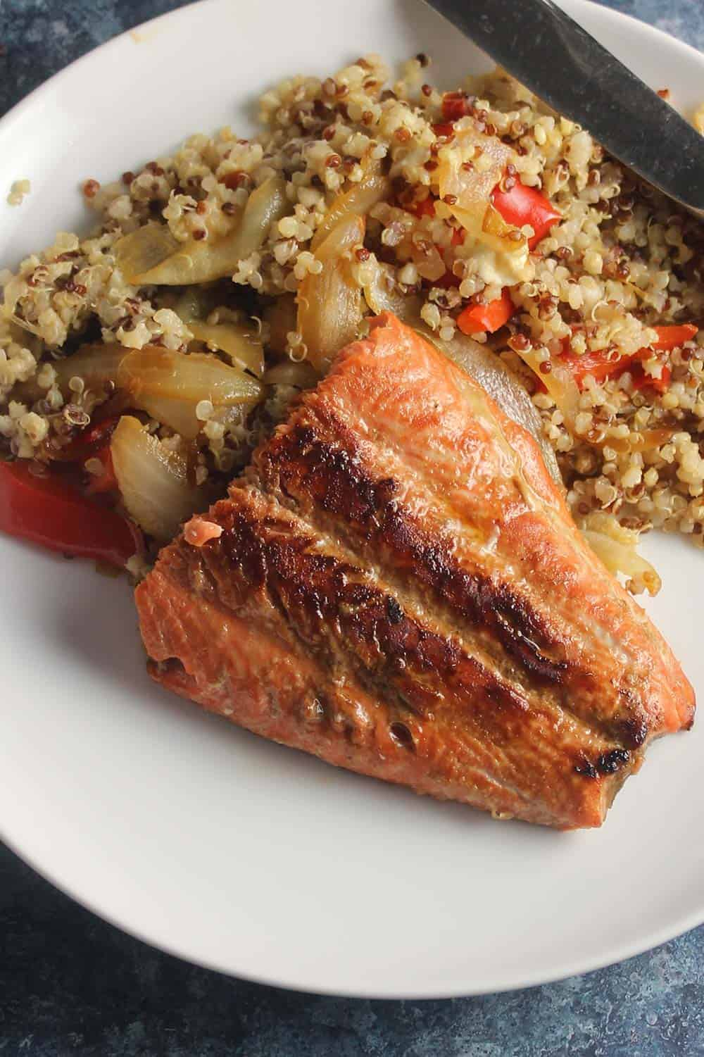salmon with plated with quinoa.