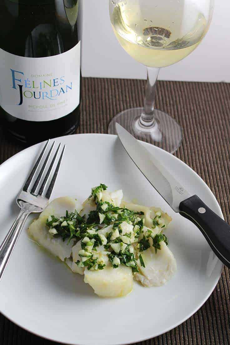 Roast cod with herb pesto paired with a Picpoul de Pinet. A nice wine pairing for a simple, healthy dinner.