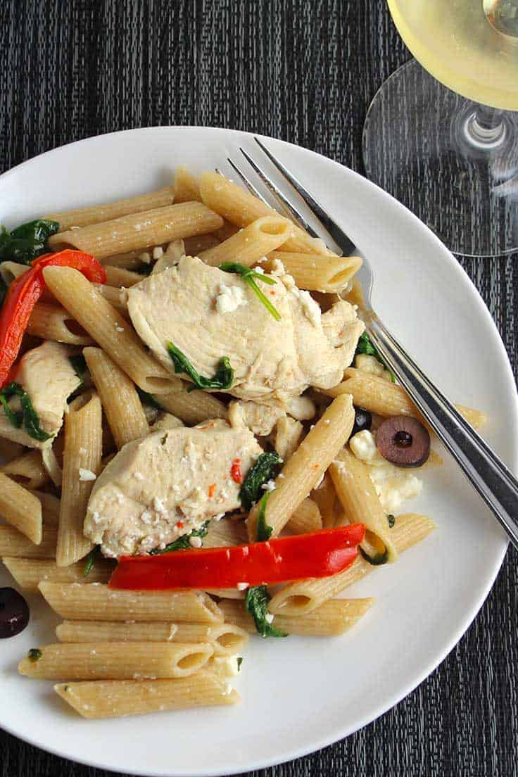 Mediterranean Chicken Pasta with Spinach and Red Peppers is a full flavored pasta recipe with garlic, olives and feta cheese.