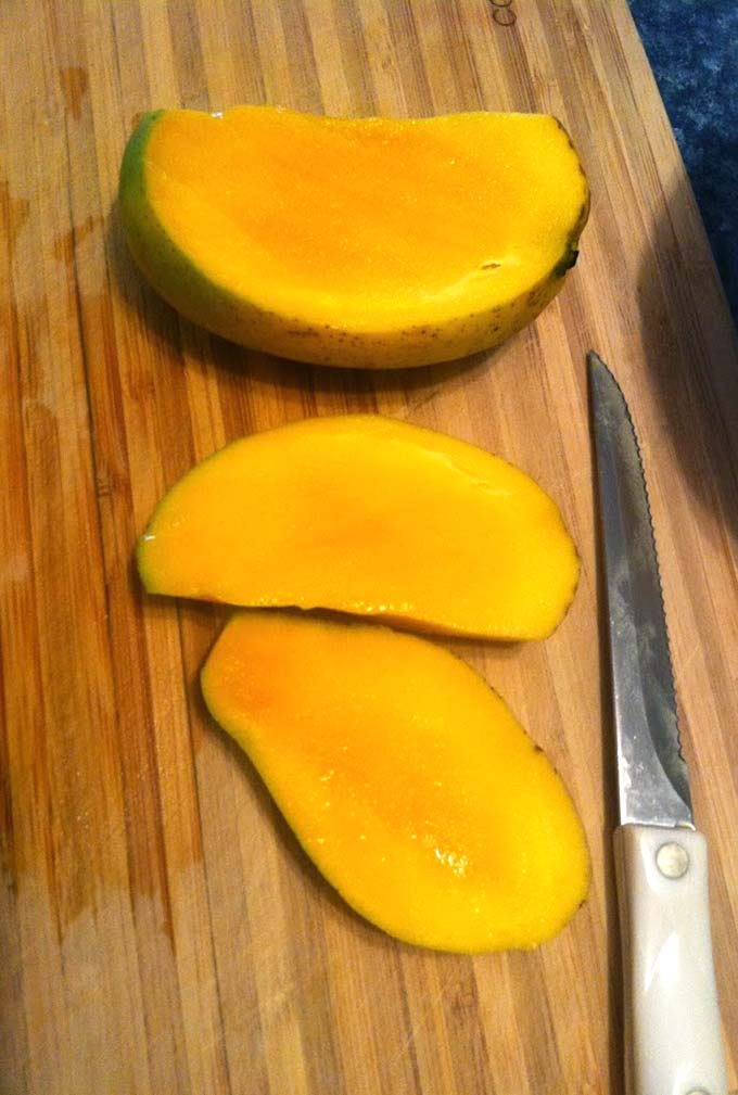 mango on a cutting board.