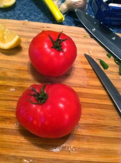 tomatoes on cutting board for Grilled Swordfish and Eggplant pasta dish