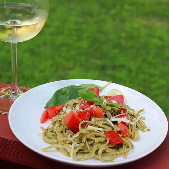 Linguine with Classic Basil Pesto, topped with tomatoes.