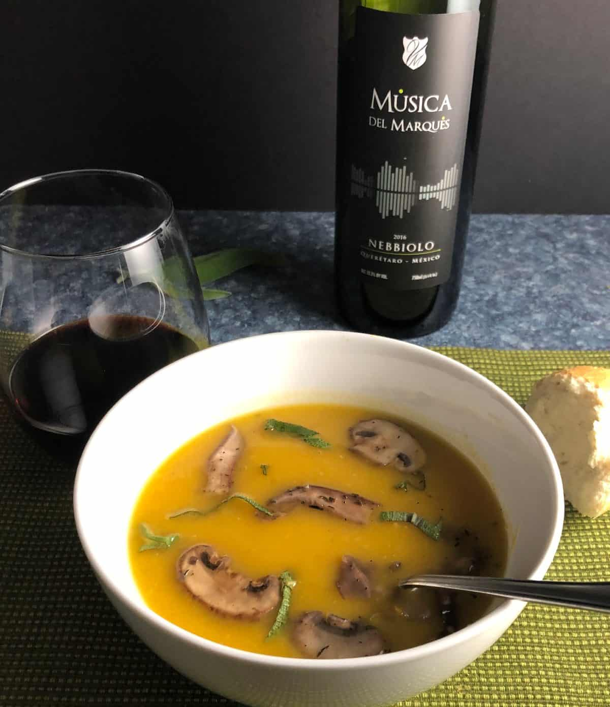 bowl of butternut squash soup paired with a red wine from Mexico.