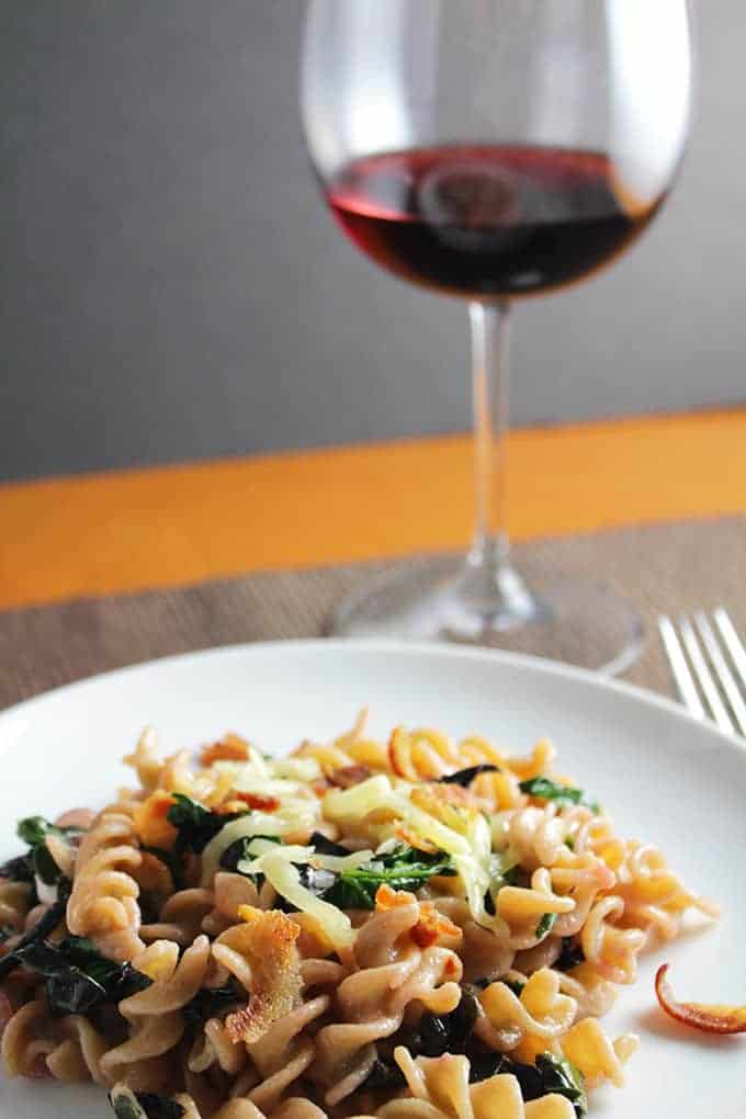 bacon and beet greens tossed with pasta and cheese, served with a Pinot Noir. Cooking Chat recipe.