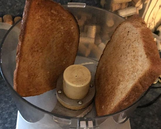 toasted bread in a food processor