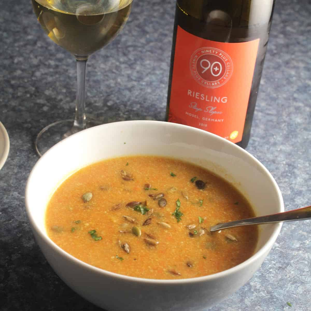 bowl of carrot ginger soup with Riesling.