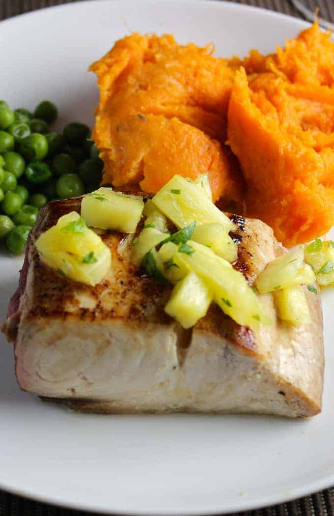 mahi mahi with pineapple salsa is a healthy fish recipe that brings a taste of the tropics to your kitchen no matter how cold it is outside!