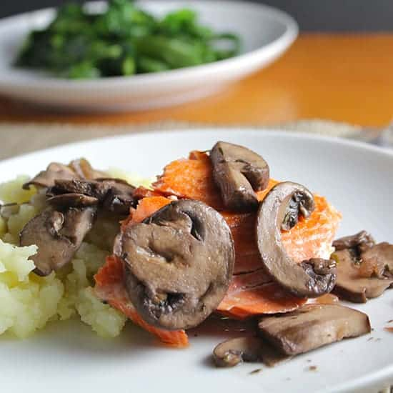Salmon with Mushrooms served with mashed potatoes.