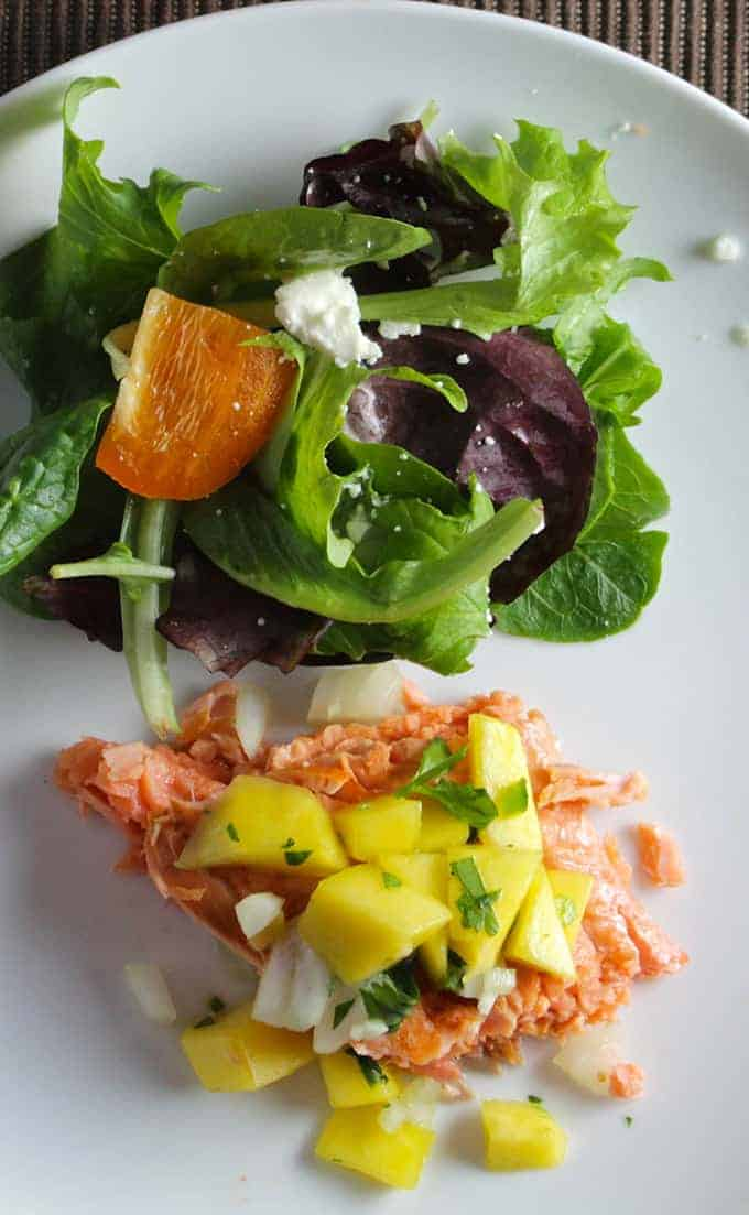 Salmon with Mango Salsa, served with a green salad for a healthy meal. Cooking Chat recipe.
