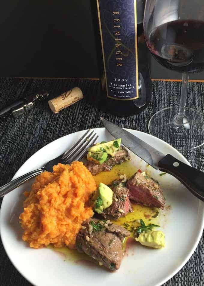 Chimichurri beef tenderloin gets great flavor from from an awesome avocado sauce for an elegant yet easy meal! Delicious served with a special red wine.