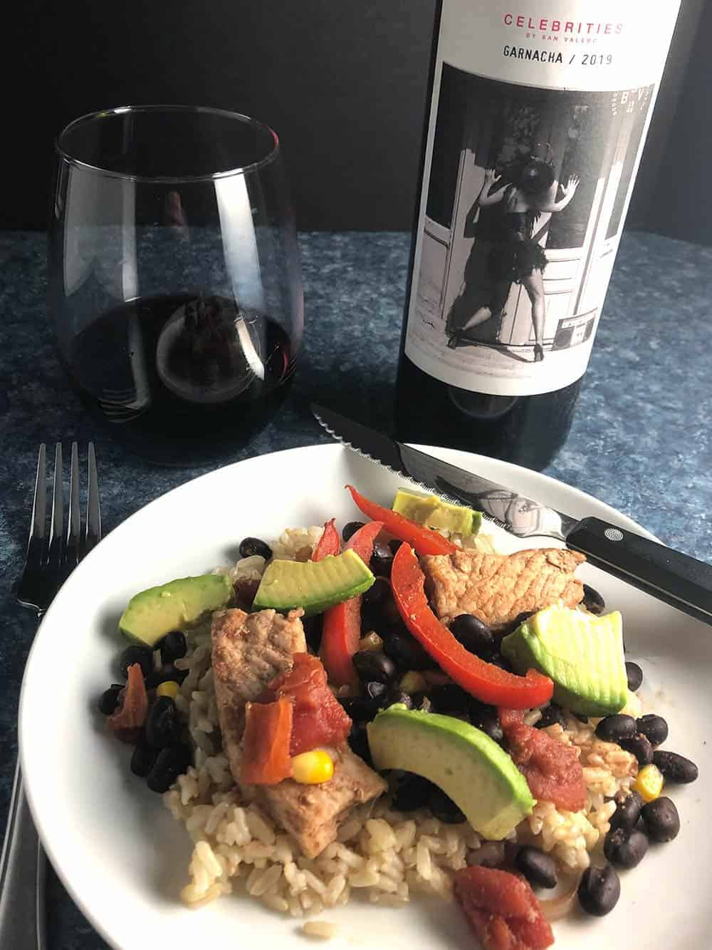 pork and black beans served with red wine.