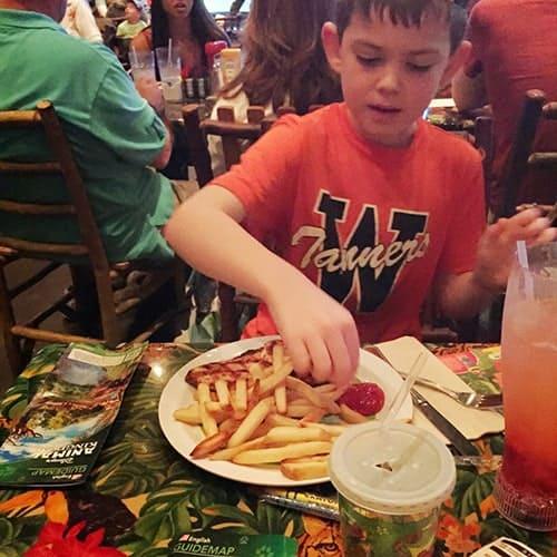 enjoying allergy safe fries at Rainforest Cafe.
