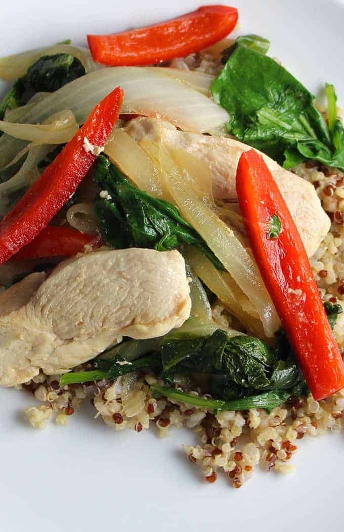 skillet chicken cooks quickly with baby kale, onions and peppers for a quick and healthy meal.