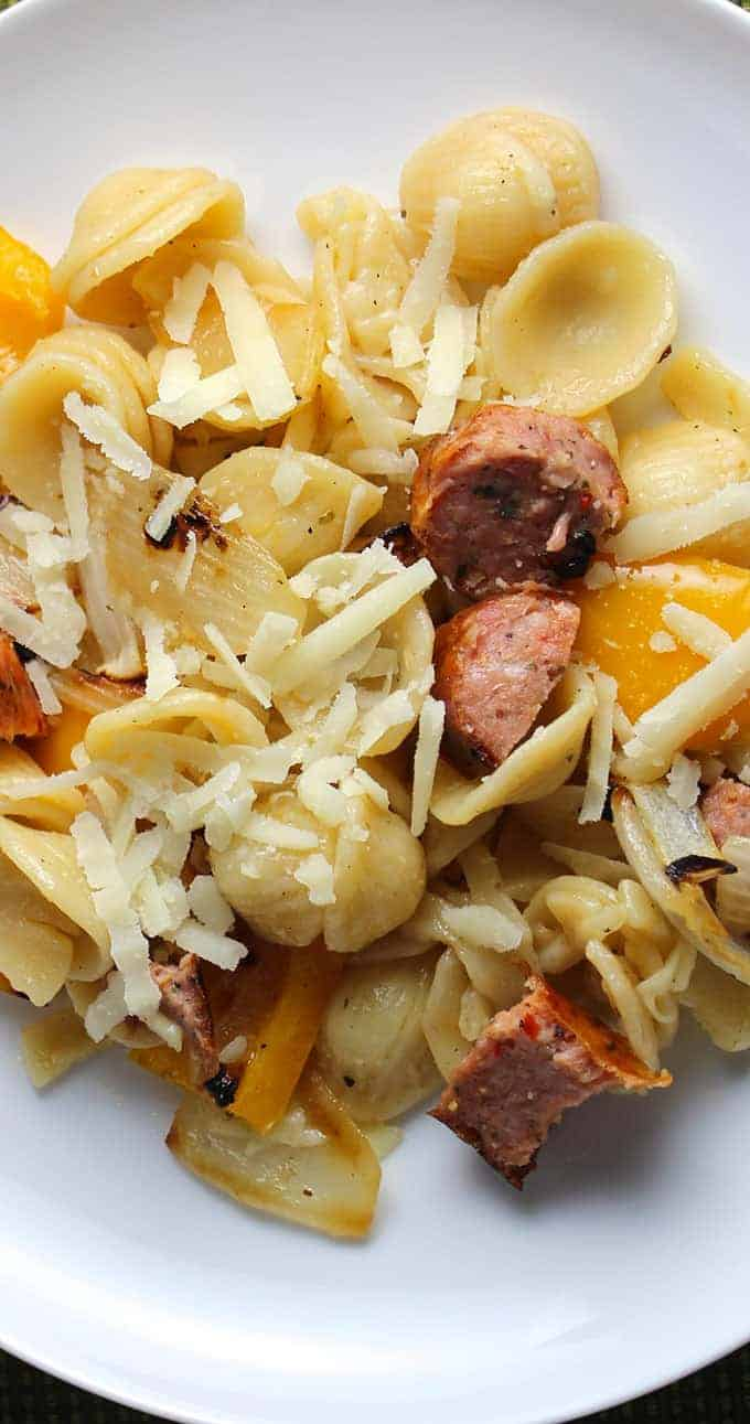 Orecchiette with Grilled Sausage, Onions and Peppers topped with Pecorino cheese.