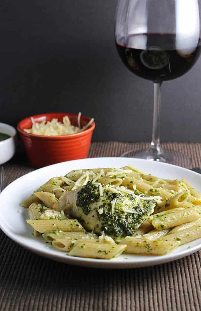 Baked Chicken with Pesto and Penne, served with a red wine.
