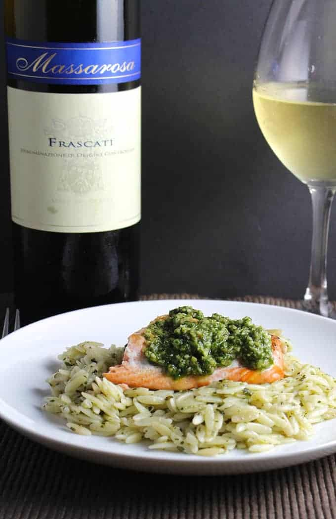 Orzo, Salmon and Pesto on a plate paired with white wine.
