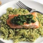 salmon served with pesto and orzo