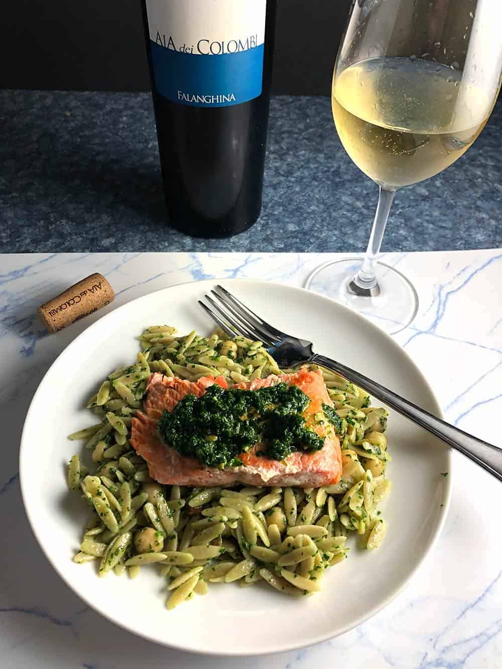 salmon served with pesto and orzo.