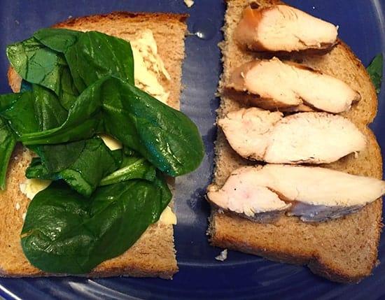 making grilled chicken sandwich.