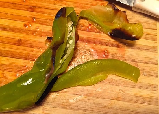 slicing grilled Hatch chile pepper for an avocado salsa recipe | cookingchatfood.com