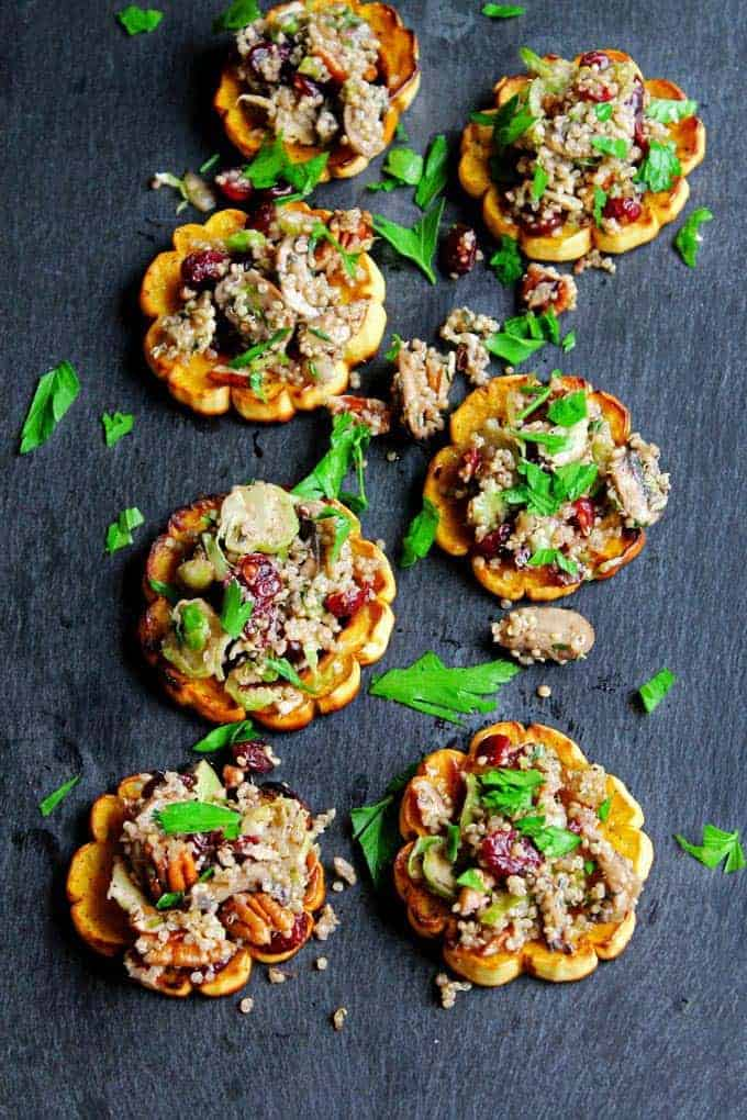 Quinoa stuffed delicata squash with mushrooms, cranberries and pecans from Rhubarbarians