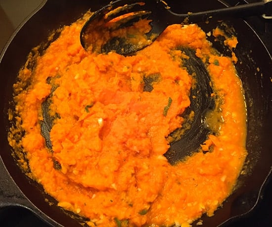 Sweet potatoes cooking in skillet, to be tossed with orzo and leftover turkey.