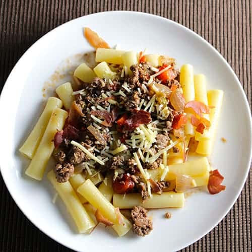 Bolognese Sauce with Crispy Proscioutto is a meat sauce recipe at its best, delicious paired with an Italian red wine. Picked for Cooking Chat red wine pairings roundup.