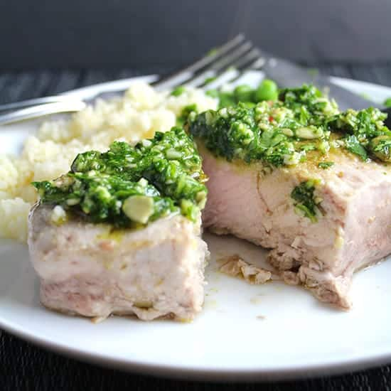 Cilantro Pesto Pork Chops recipe features chops roasted just right in the oven topped with a zesty sauce.