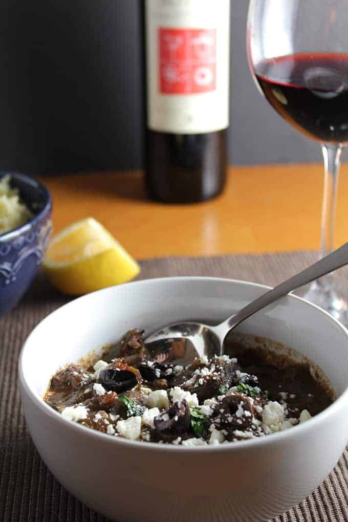 Greek Lamb Stew has slow cooked, tender lamb, topped with some feta cheese and olives, wonderful served with a Greek wine. From Cooking Chat wine red wine pairings roundup.