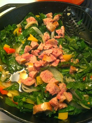 greens slowly cooked with onions and pepper, with sausage added at the end, serve as the basis for a tasty pasta dish.