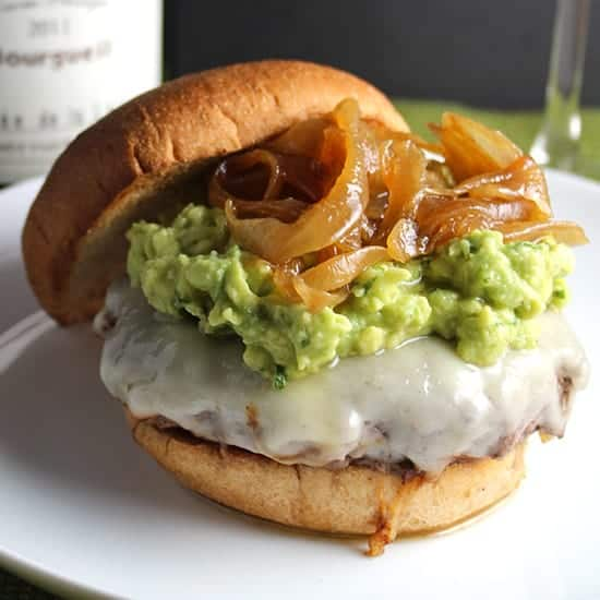Guacamole Cheeseburger Topped with Caramelized Onions and paired with a Cabernet France wine, a top red wine pairings pick from Cooking Chat.