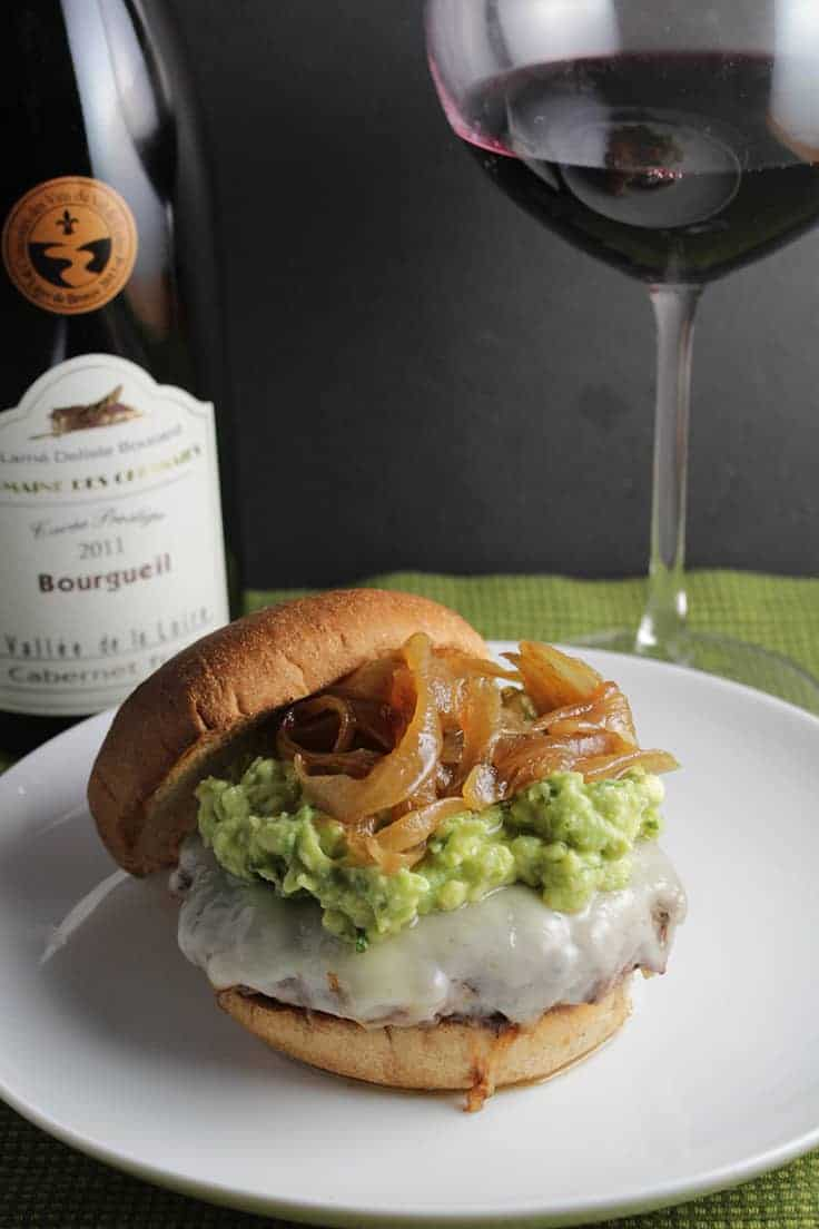 This burger topped with cheese, tasty guacamole and caramelized onions is downright decadent, and gets even better with a glass of Cabernet Franc. An easy gourmet dinner!