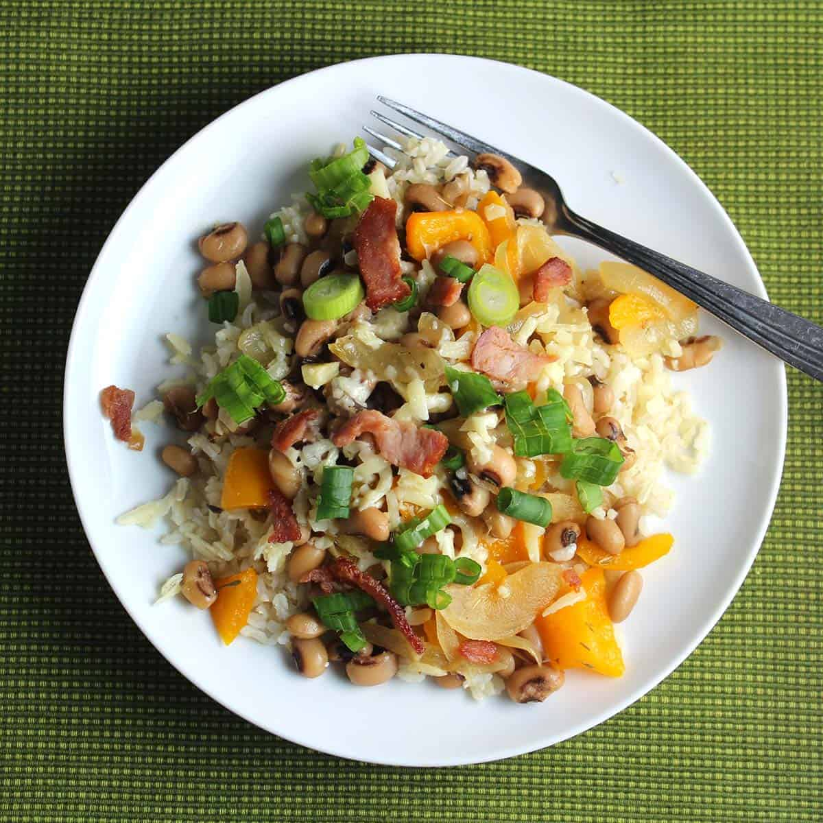 hoppin' john on a white plate.
