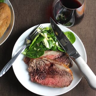 strip roast beef recipe topped with a simple red wine sauce.