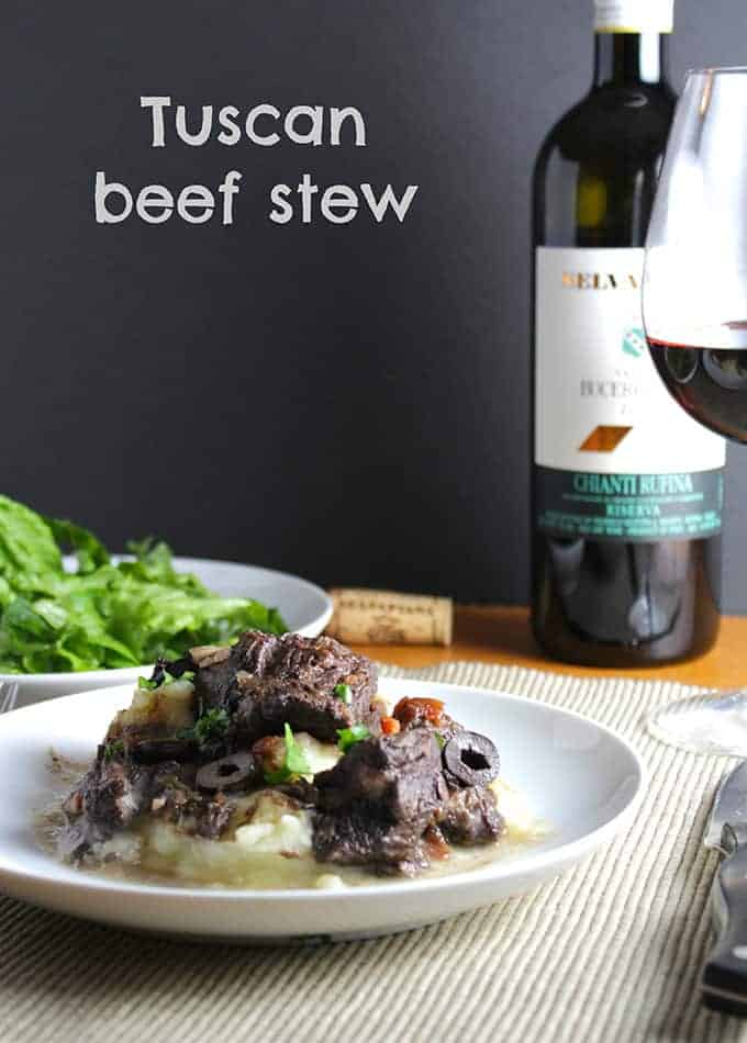 Tuscan beef stew recipe, with beef so tender after a long simmer in red wine, paired with a Chianti. A Cooking Chat red wine pairings pick.