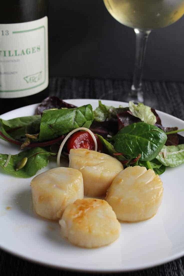 Simple Pan Seared Scallops with a garlic soy sauce for a delicious meal. Serve it with a nice wine and it's even better!