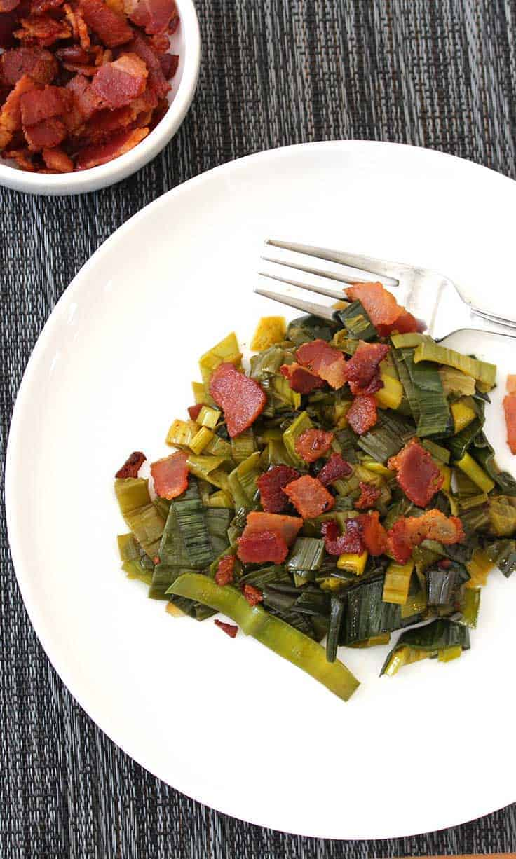 Sautéed Leek Greens with Bacon recipe is a delicious way to make use of a too often discarded portion of the leek vegetable.