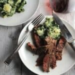 plate with steak and mashed potatoes and swiss chard