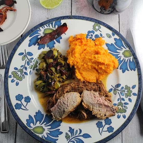 Slow cooker pulled pork served with sweet potatoes, sauteed leeks and pork tenderloin.