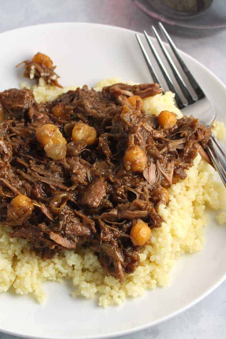 Dig into some delicious Apricot Lamb Tagine, with fall-apart tender meat and a tasty blend of savory, sweet and spice. Moroccan style recipe.