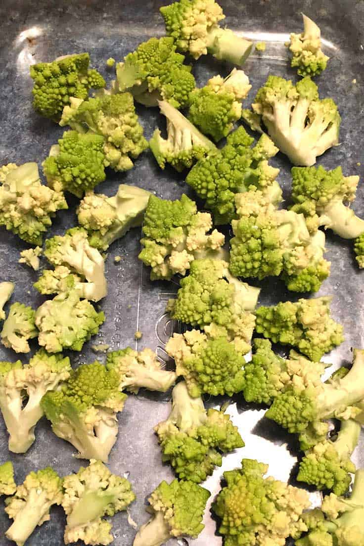 Easy new veggie side dish! Chop Romanesco, toss with some olive oil and garlic, roast for 20 minutes and add some cheese.