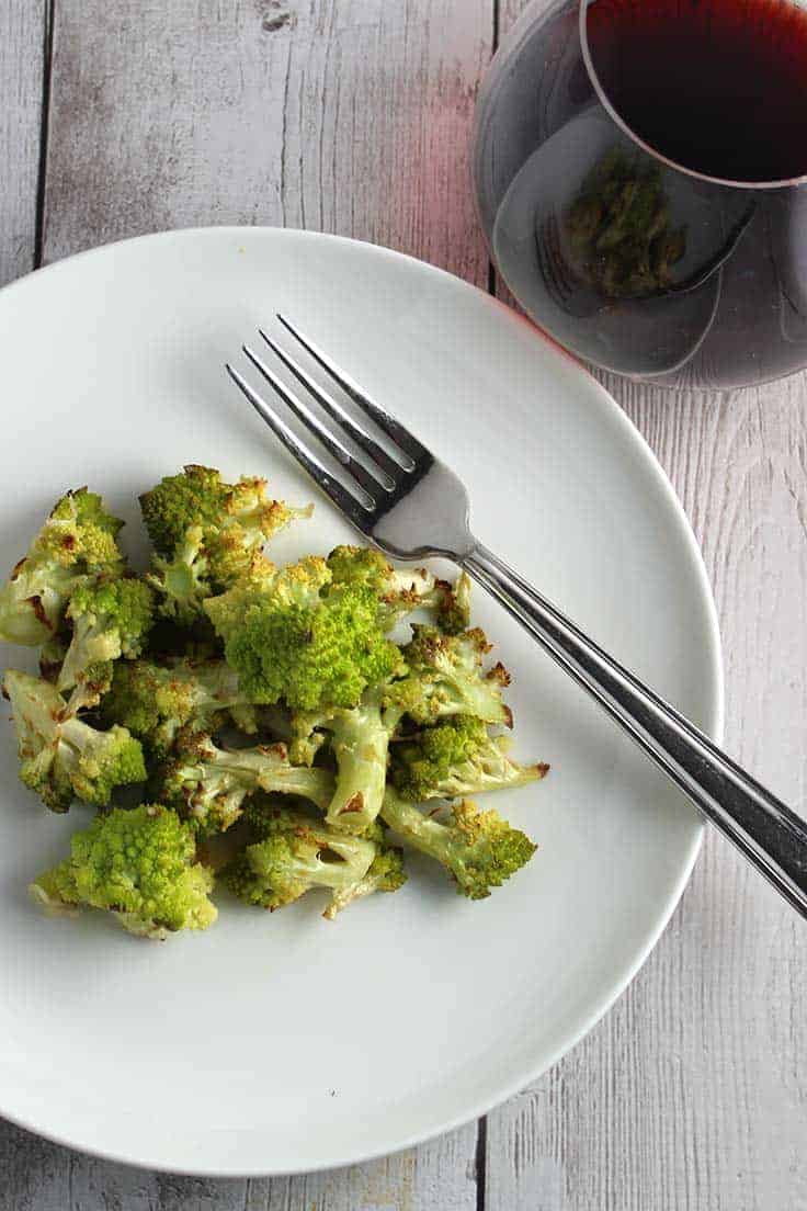 Roasted Romanesco: try an easy and tasty new vegetable side dish! Tossed with olive oil, garlic and Parmigiano cheese, for a nutty, flavorful side dish recipe.