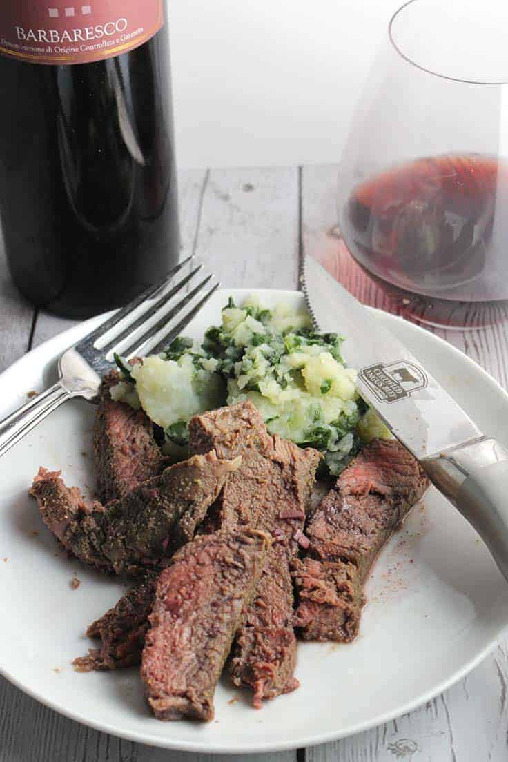 roasted sirloin plated with a red wine garlic sauce.