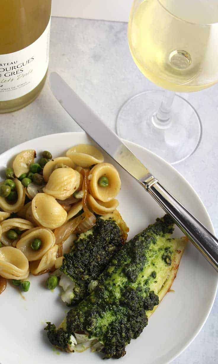 Kale Pesto Tilapia is an easy and healthy recipe to make, and pairs nicely with a white Rhone wine.