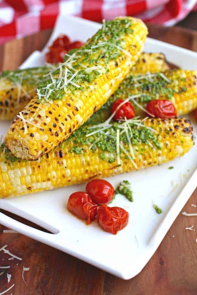 Grilled Corn with Kale Pesto from Grab a Plate, from kale pesto recipe roundup.